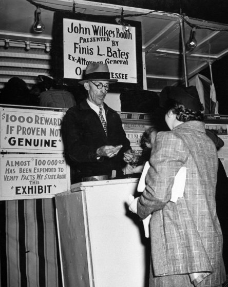 """Twenty-five cents admission is charged to see the mummy. 'Barney' Harkin tends gate. His wife does the explaining,""  LIFE , July 11, 1938.  William Vandivert—The LIFE Picture Collection/Getty Images"