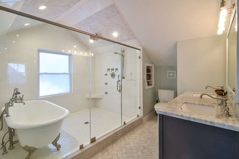 PROJECT : Created master ensuite bathroom   DETAILS : Converted attic to master suite, and ensuite - herringbone marble tile work, installed double vanity with quartz countertop, installed double shower and clawfoot tub, fixtures, & lighting