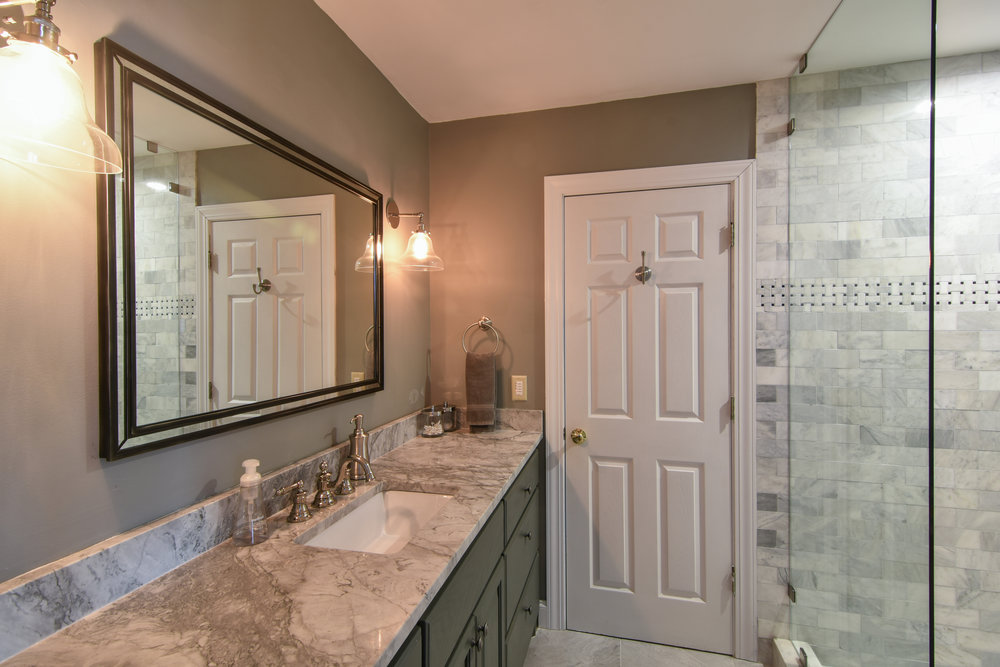 PROJECT : Complete bathroom remodel, Johns Island   DETAILS : Intricate tile work, installed frameless glass shower surround, painted cabinetry, new quartz countertop, mirror and light fixtures