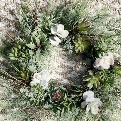 adding flat pieces of succulents to an existing wreath.JPG