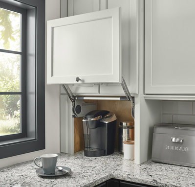 Kraftmaid  The need for custom cabinets, including those with a built-in appliance garage, should be determined prior to any electrical installation, as these will require additional outlets.