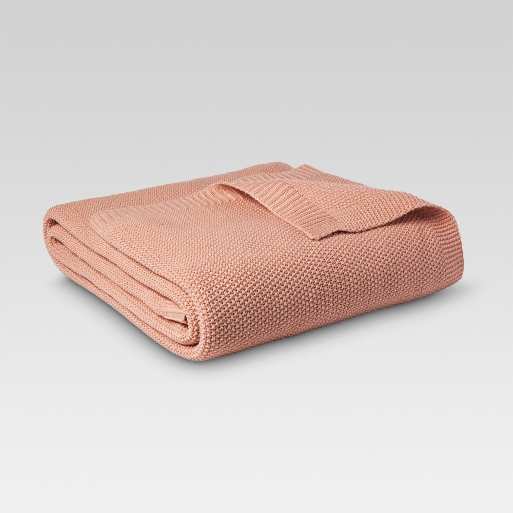 coral throw feels like a sweater and is perfect for fall decorating