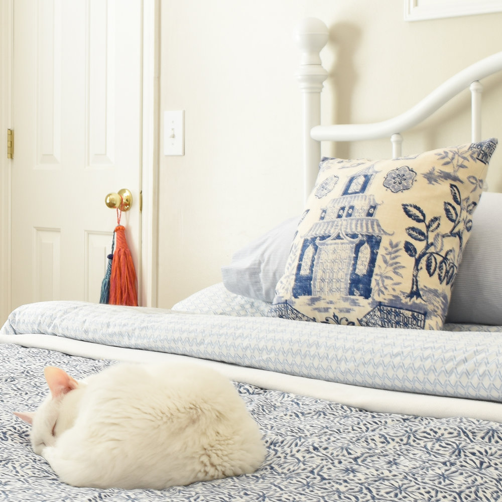 decorating with blue - mix patterns and tones to create a layered bedding look