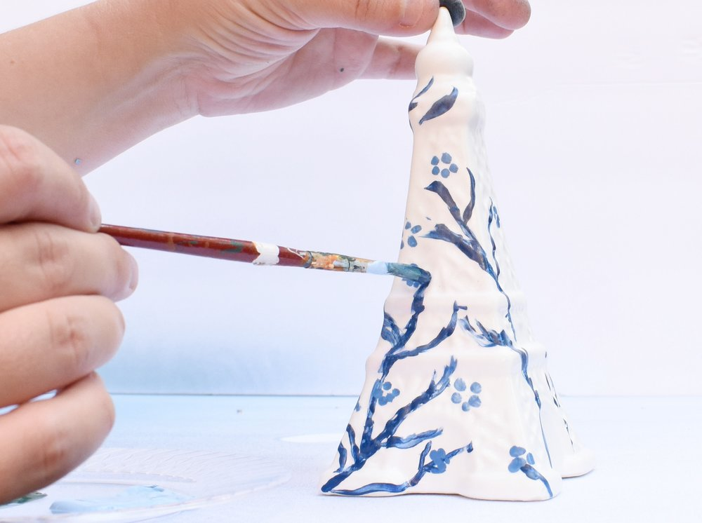 DIY chinoiserie style on dollar store figurine