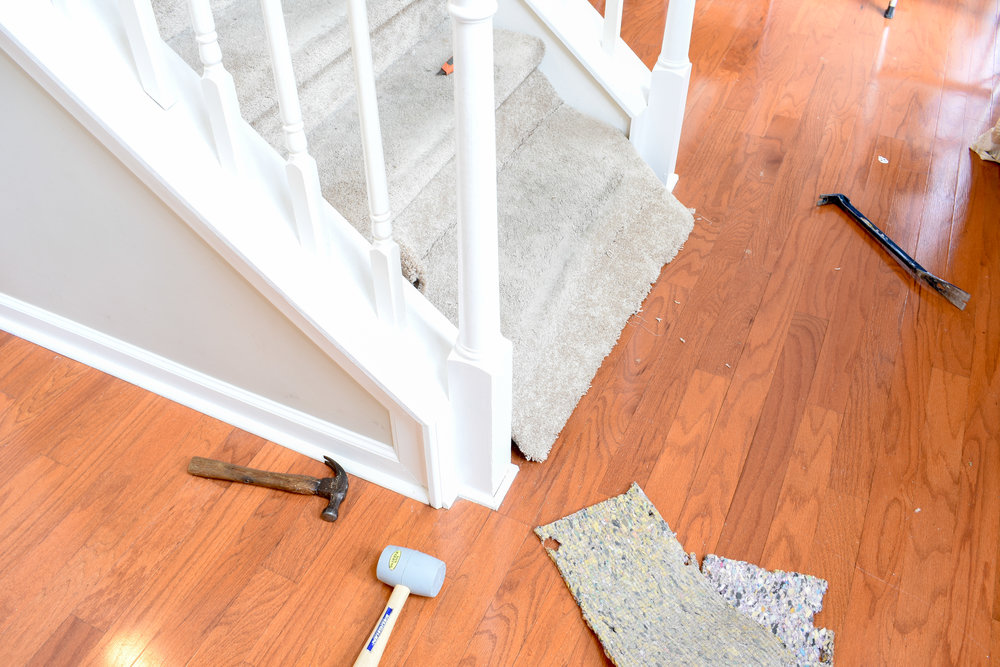 removing carpet on stairs to replace with hardwood