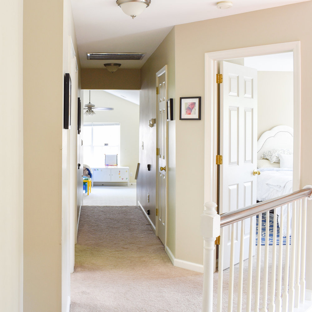 this dated suburban hallway gets a major transformation with just a few tweaks