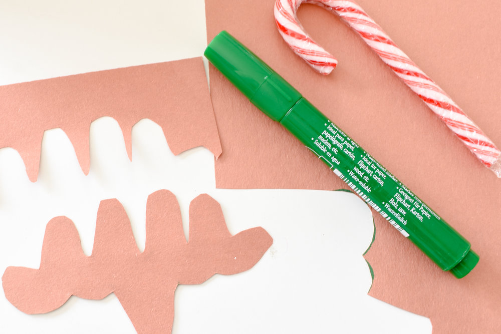DIY Candy Cane Christmas tags - Make a moose instead of a reindeer and you'll have plenty of space to write the recipient's name!