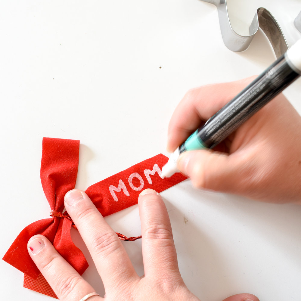 write names on bows to make cute and cheap gift tags that are way better than those stickers.