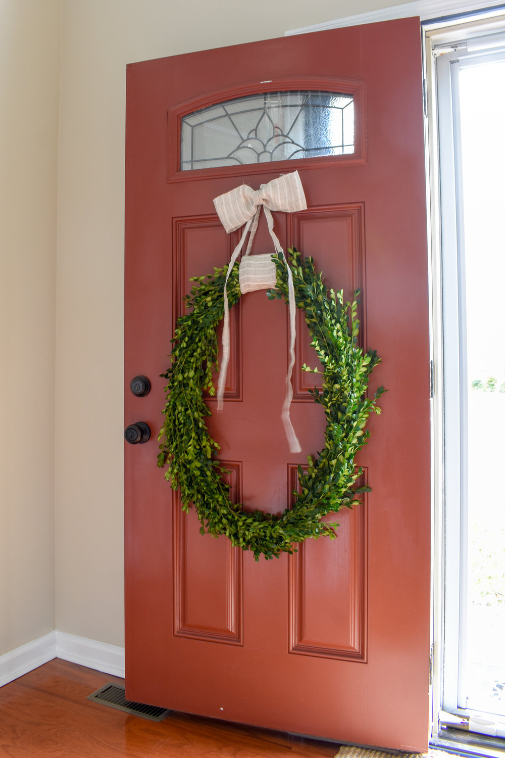 DIY Christmas wreath with a modern farmhouse style bow - tutorial on the blog for making this super easy and free boxwood wreath
