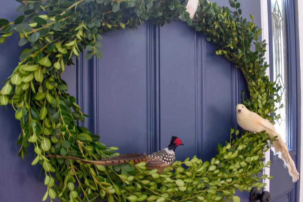 boxwood wreath with birds