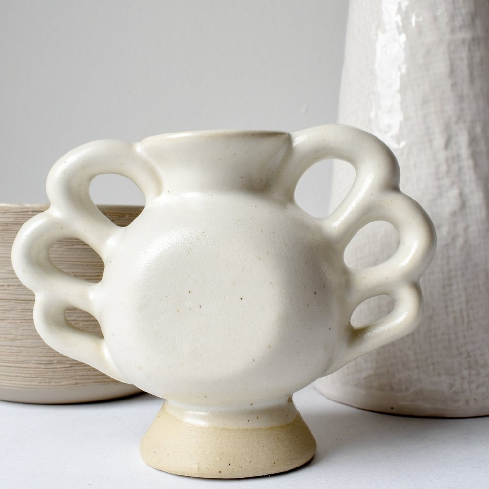 midcentury vintage pottery in neutral home