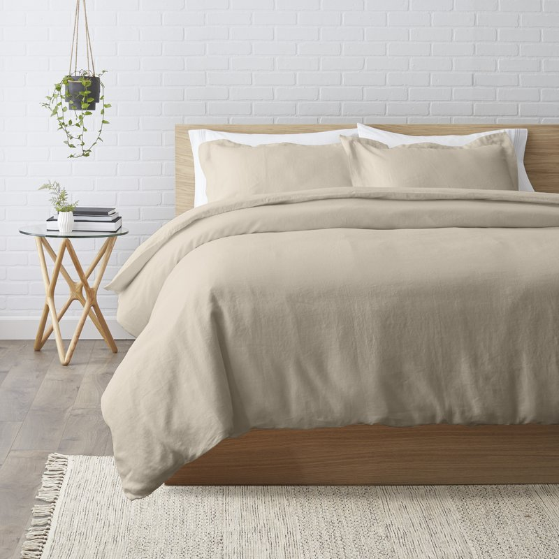 I like a bed that's layered with different textures and colors. Adding all this extra stuff can make it feel busy. So I tread lightly with a very basic duvet cover as the foundation. The one thing I won't hold back on? Natural materials like linen and cotton are an absolute must for my bed!