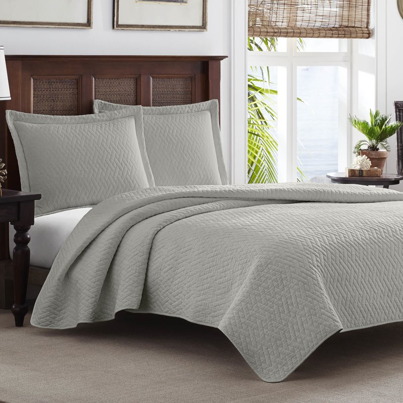 Quilts are wonderful accent pieces that will also keep your bed cozy. Adding prints is unnecessary when you can find diamond and basket weave patterns like these. The impact is layered and textural but it won't confuse the eye with contrast.