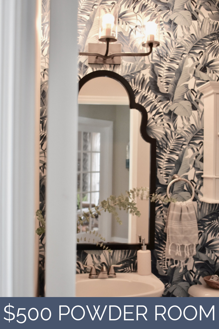 The Most Popular Project of 2018 Revealed | $500 Powder Room Makeover:  Installing wallpaper and new fixtures went a long way in brightening this previously cavernous space.