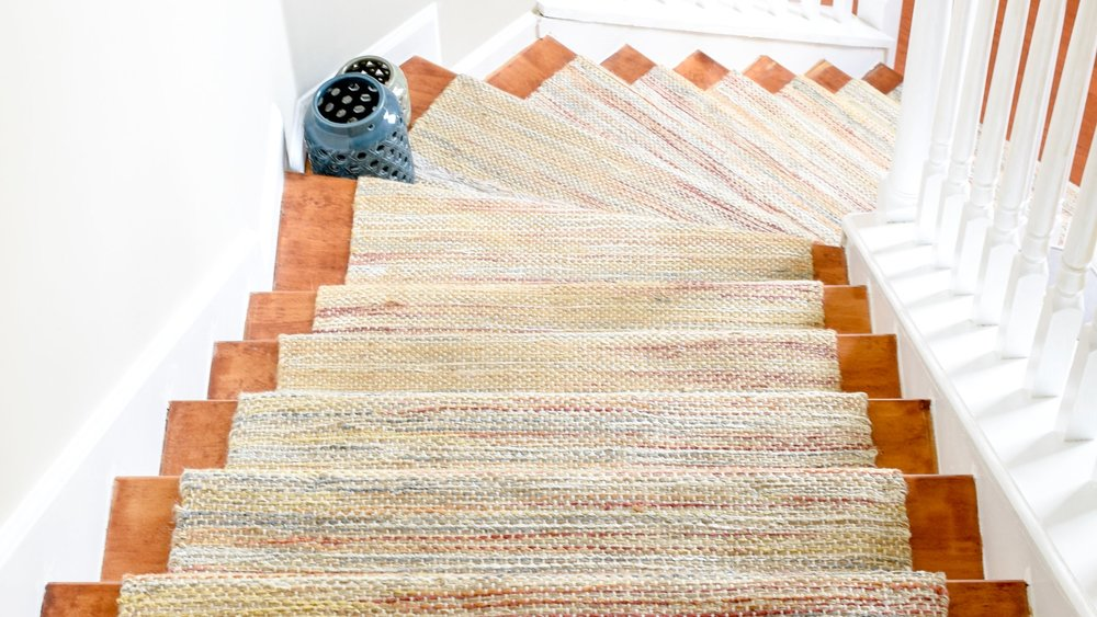 DIY Hardwood Staircase Makeover: Replacing Carpet With Wood Treads On Pie Steps And Curved Landings - Today, I'm showing you how I created a template to create the deeper stair treads that pie step landing required so you can do it yourself!