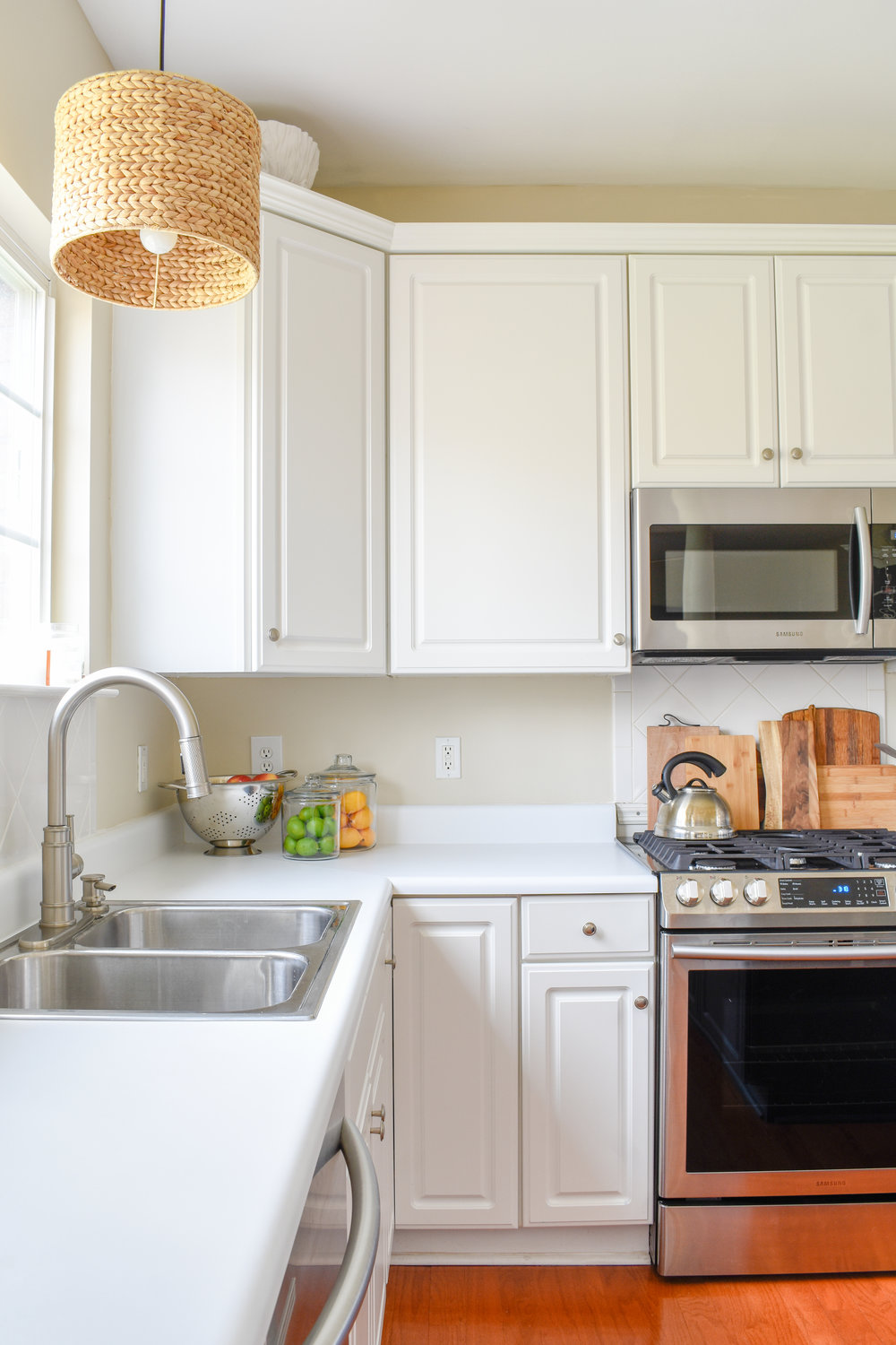 Spring Kitchen Updates: I've traded out the pine cones and candy canes for lemons and limes. I've also cleaned off the tops of our counters and cabinets, in anticipation of the new countertops and backsplash we'll be installing soon. #springcleaning