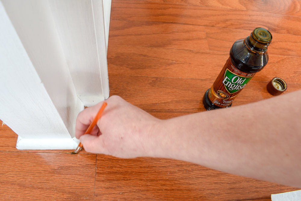 fixing small nicks in wood flooring with this quick and easy method