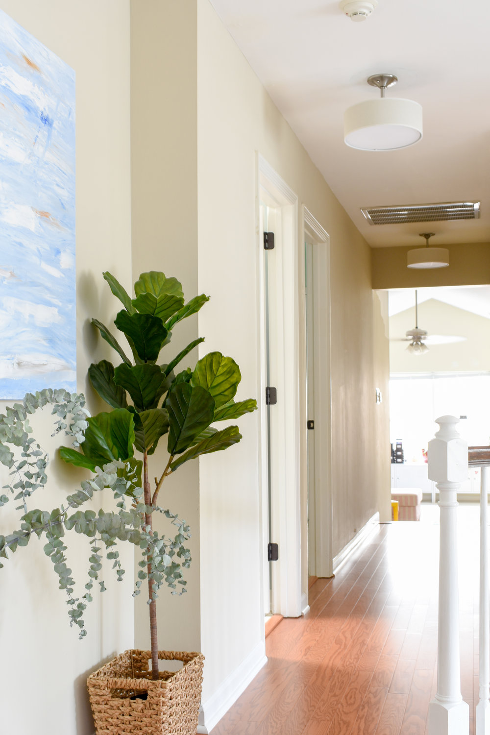 Hallway Makeover: You can peek into the bonus room from this end of the long upstairs hallway.