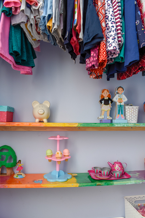 Kid's Closet Playroom Makeover: How To Stain Wood In Rainbow Colors - This is such an easy method to achieve vivid colors and a high gloss finish that allows you to embed stickers and glitter! #kidsdecor #girlsroomdecor #tweendecor #kidsbedroomstorage #toystorageideas