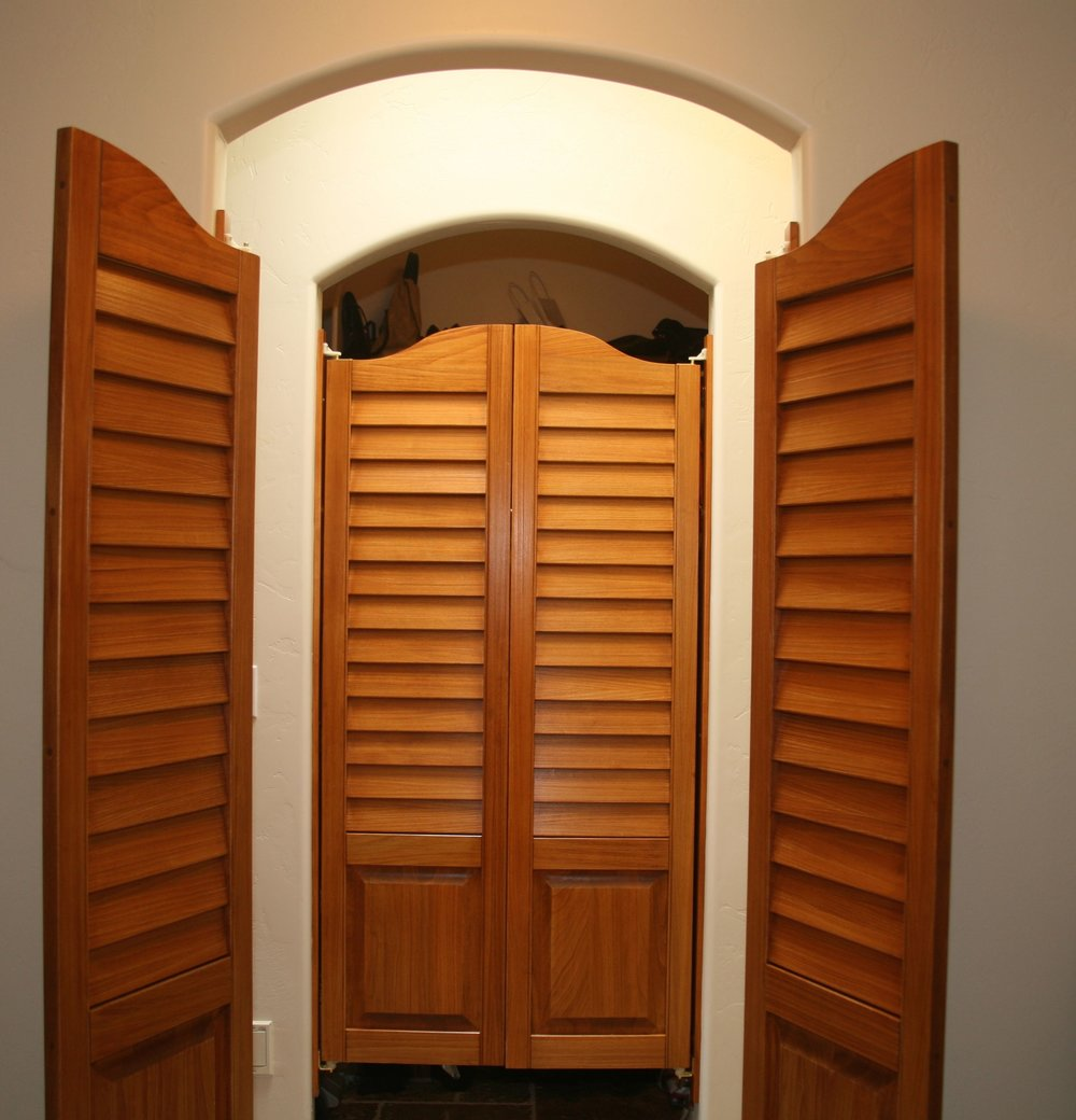 Swinging saloon-style doors provide ease of passage through each room while blocking them off in an aesthetically pleasing manner.