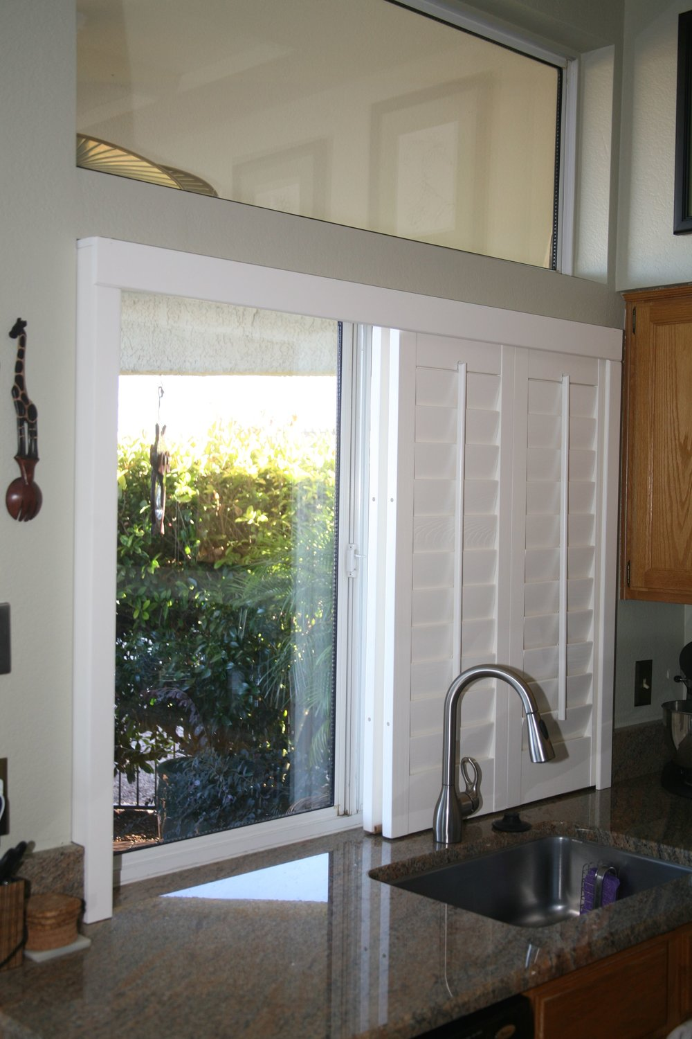 Bypass sliding panels make seeing out of windows easier in comparison to swinging shutter doors.