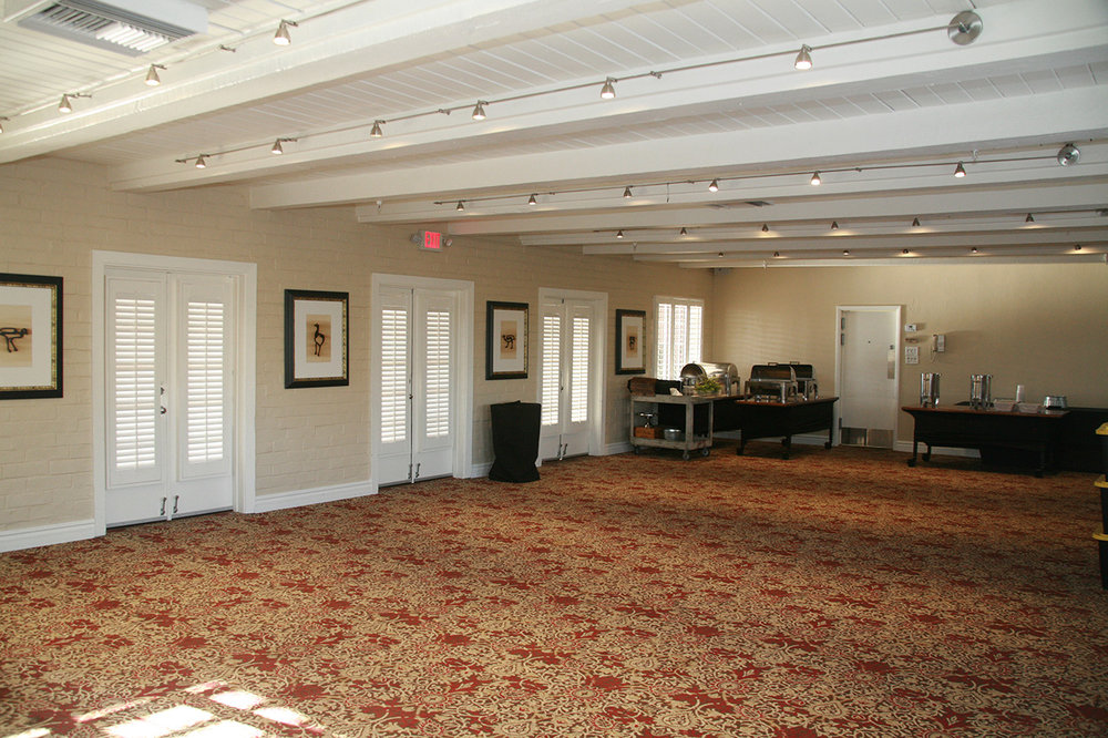 The Westward Look - It's crucial that meeting rooms offer light control and privacy. We enhanced the aesthetics of the room with color matching to the ceiling, doors and trim, while creating a solution for covering the windows on their doors that don't swing or need to be clipped when opened or closed.