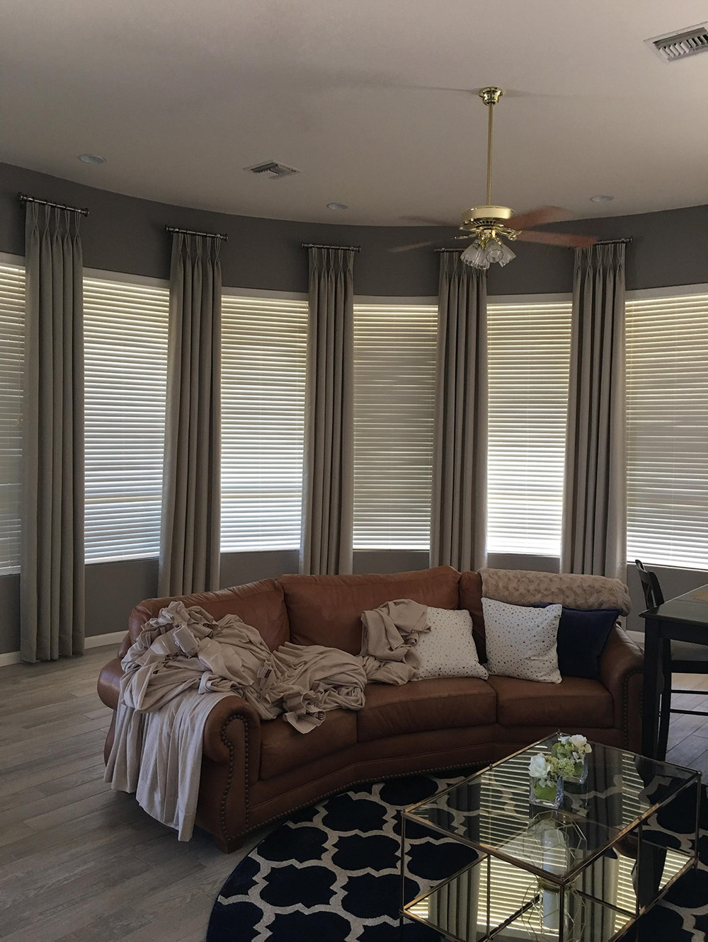 An example of blinds and draperies in a curved room.