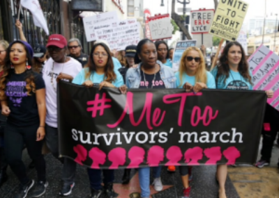 Tarana Burke, center, founder of the #MeToo movement, at a march last month in Hollywood. (Damian Dovarganes/AP)