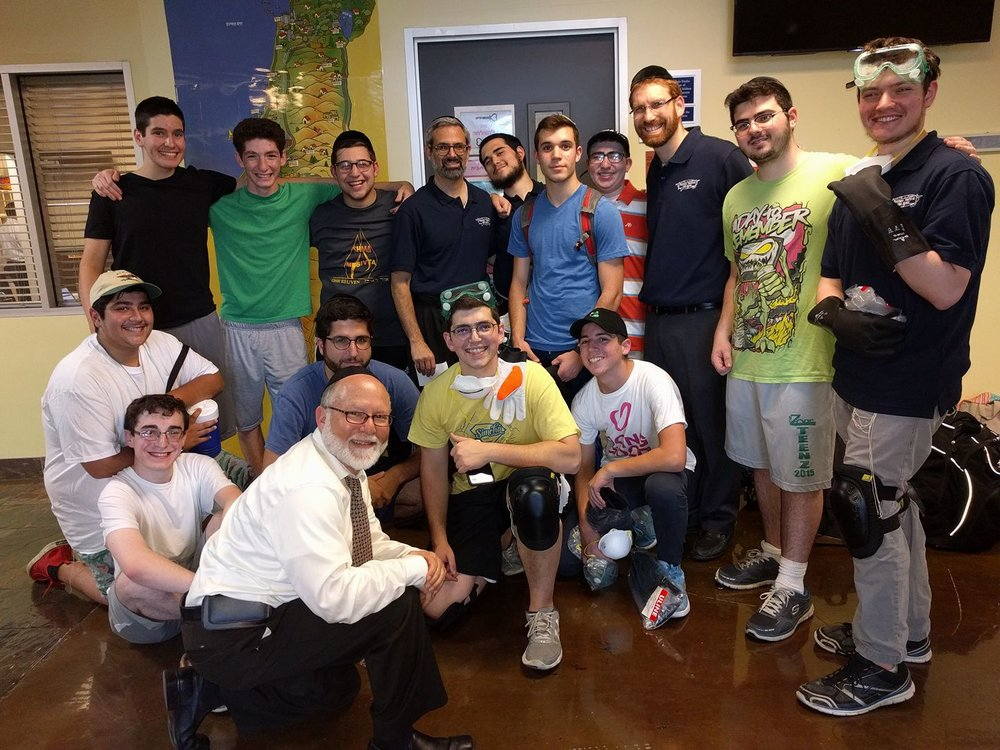 Over twenty yeshiva students from the Skokie Yeshiva are front and center in Houston today to help pick up and build