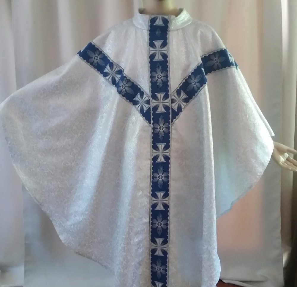 """Chasuble handmade White and silver baroque metallic brocade. Adorned with 3.25"""" blue and silver embroidered banding."""