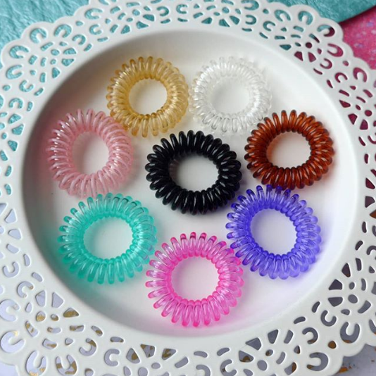 Gummibands come in 8 colours - - black, brunette, blonde, clear, light pink, dark pink, teal and purple!