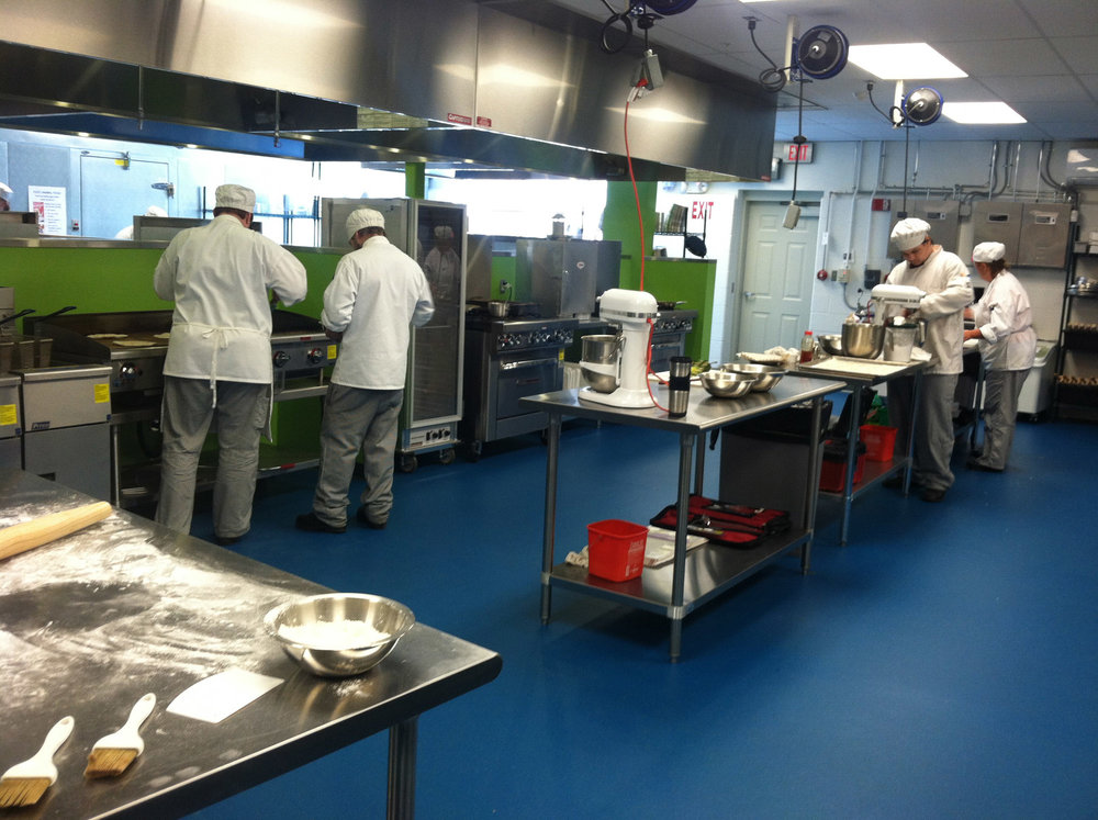 Students are hard at work at Kennebec Valley Community College as part of their culinary training.  Preparing local foods is part of the curriculum for these students at KVCC.