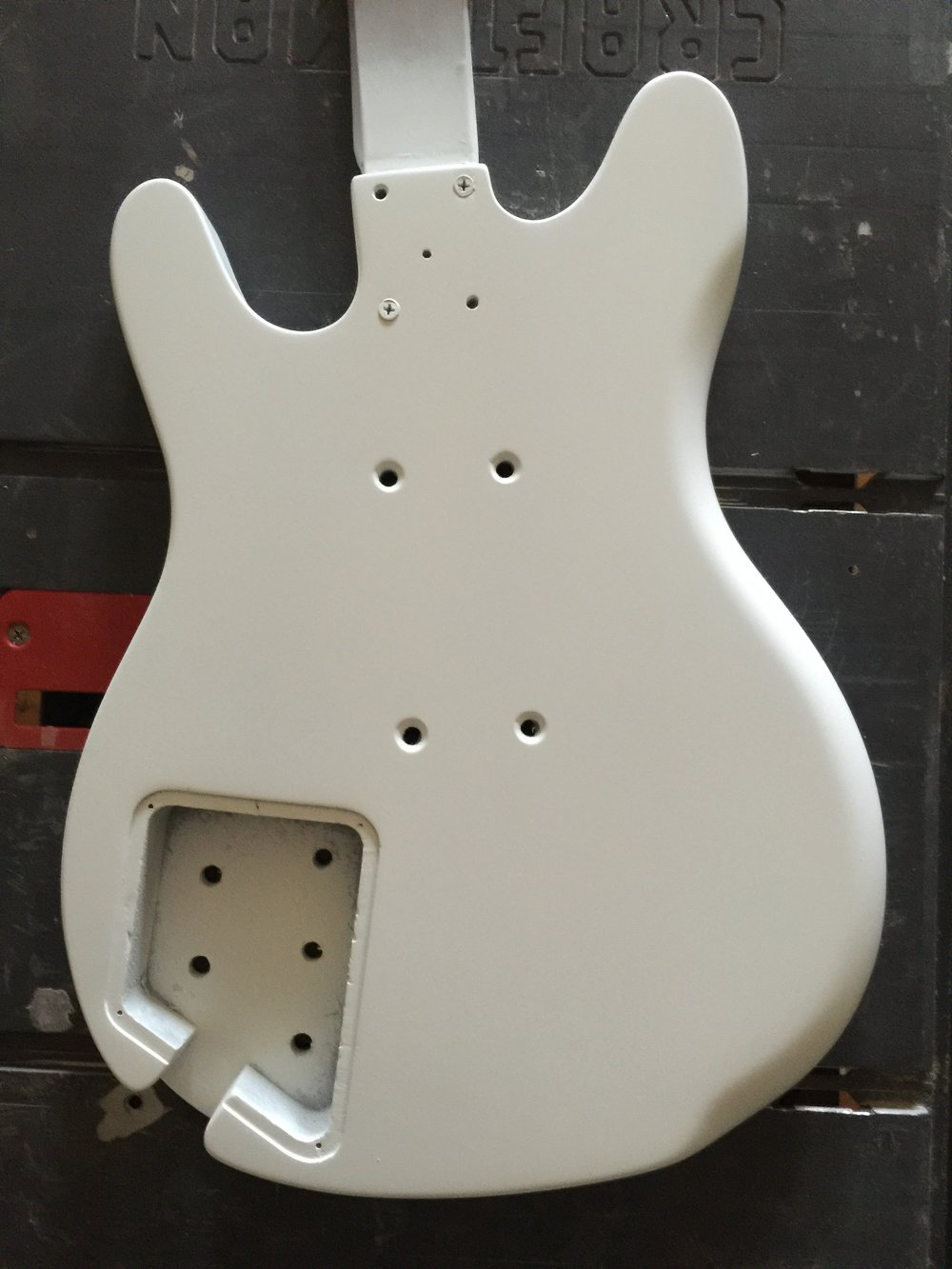 AFTER PRIMING, A MATTE WHITE GROUND COAT WAS SPRAYED