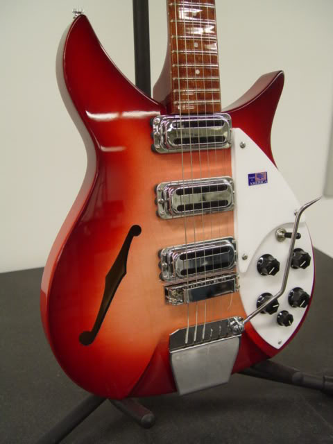 """F"" HOLE IS A GOOD PERIOD ADDITION TO A NEW RICKENBACKER 1996"