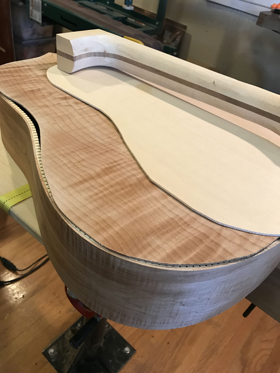 "THE MAKINGS OF A 730L DREADNOUGHT. A BODY ""HOOP"", ROUGH-CUT TOP AND BACK, AND A ROUGH-CUT AND ONLY PARTIALLY-SHAPED NECK BLANK."