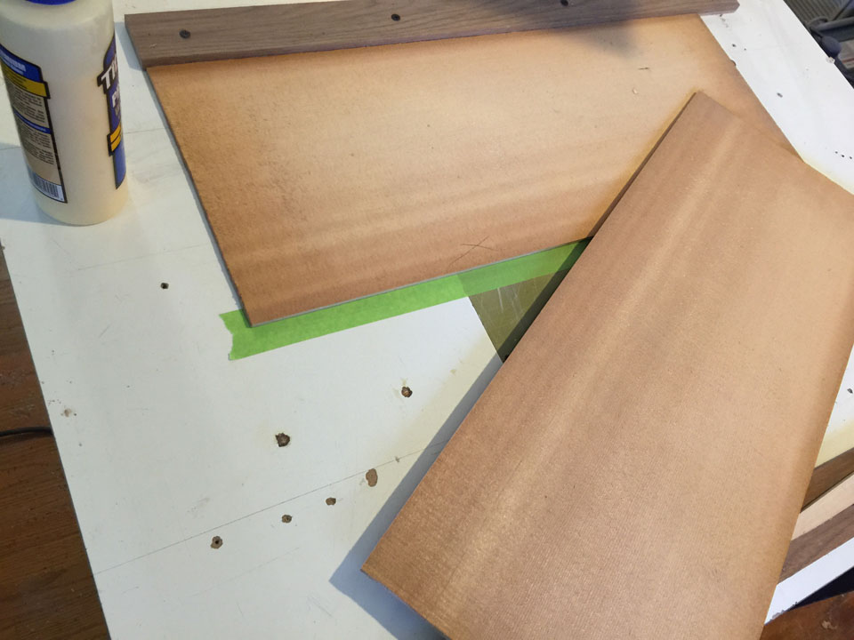 TWO ROUGH-CUT, BOOKMATCHED SPRUCE PANELS ARE READIED FOR GLUING INTO A ROUGH TOP PIECE.