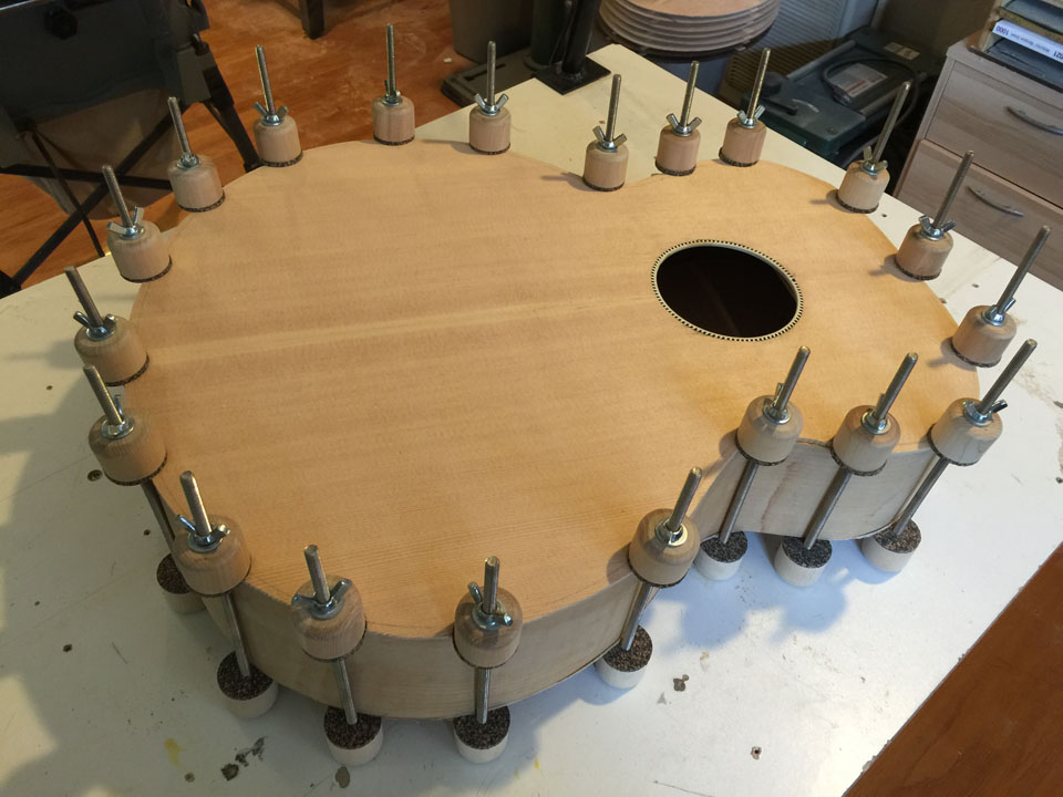 "TOP AND BACK ARE GLUED SEPARATELY, CLAMPED WITH CORK-PADDED ""SPOOL"" CLAMPS."