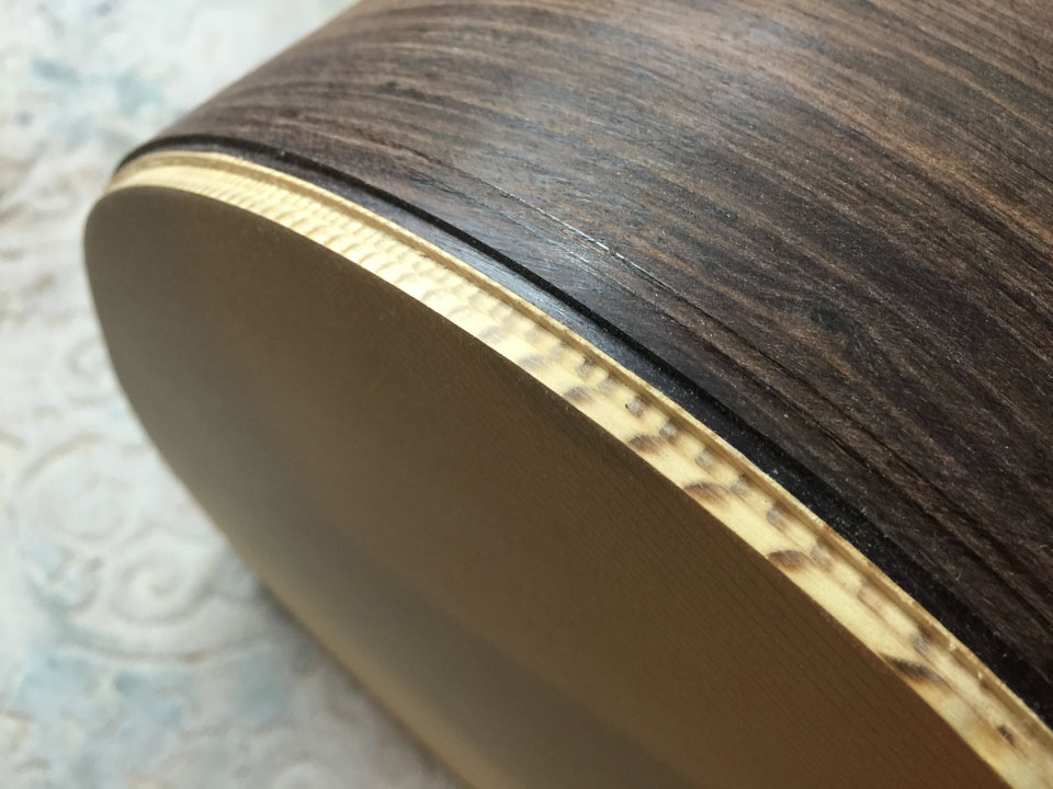 TOP AND SIDE OF A SPRUCE/ROSEWOOD 730S DREADNOUGHT, SHOWING THE DOUBLE-STEP ROUTING PROCESS.