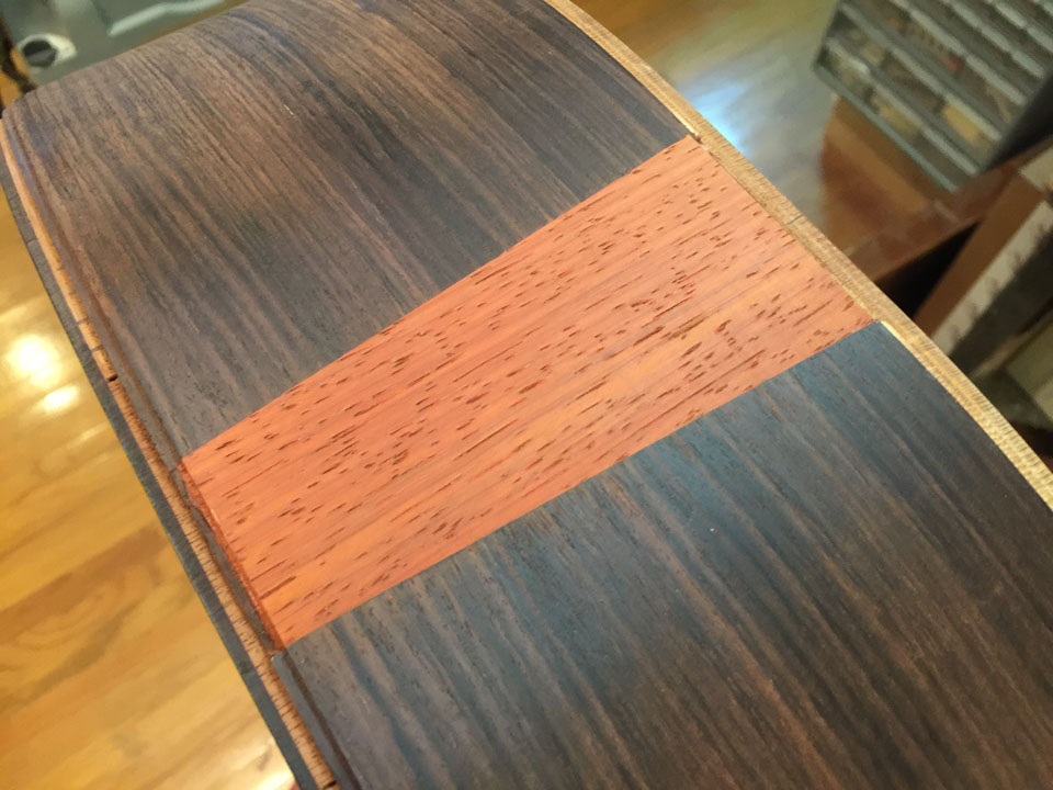"""HERE THE WOOD """"FLASH"""" HAS BEEN SANDED FLUSH WITH THE SURROUNDING SURFACE, AND THE BINDING ROUTE HAS BEEN EXTENDED ACROSS THE WOOD PIECE."""