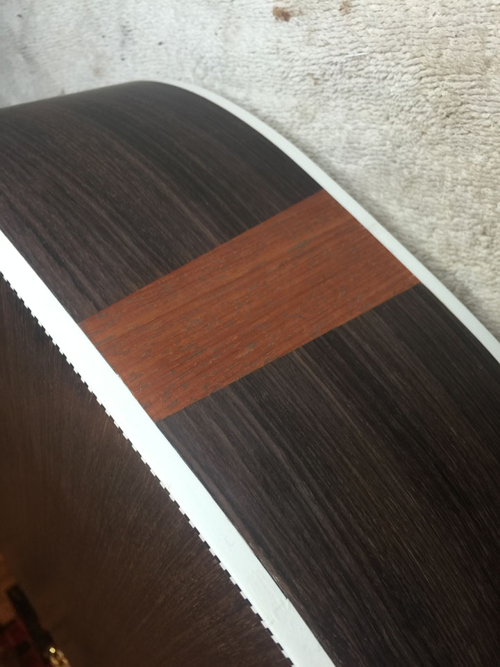 """A PADAUK """"FLASH"""" ON A ROSEWOOD 730S, ONCE IT HAS BEEN BOUND AND THE BINDING SCRAPED FLUSH."""