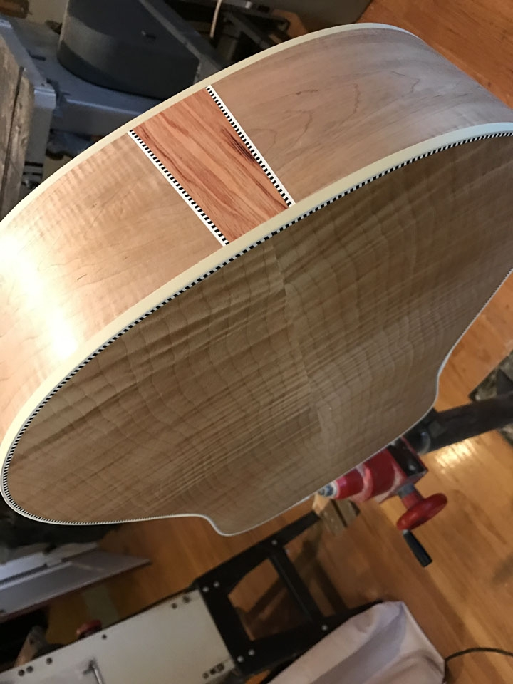 "A TULIPWOOD ""FLASH"" WITH CHECKERBOARD AND WHITE BOUND EDGES, ON A MAPLE GUITAR."