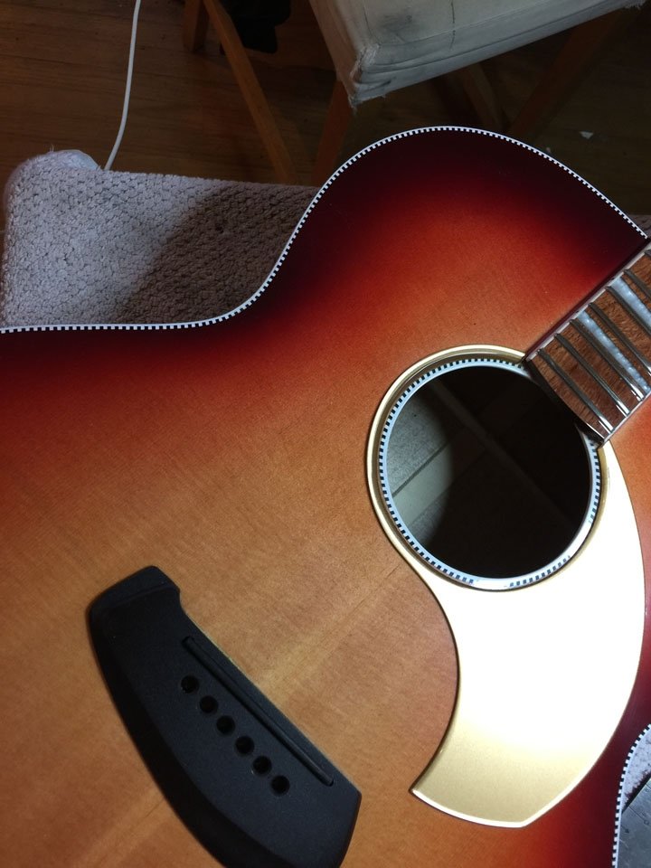 """BOOMERANG"" BRIDGE AND ""TEARDROP"" PICKGUARD: TWO UNMISTAKEABLE FEATURES OF A MADELEINE STRINGS INSTRUMENT."