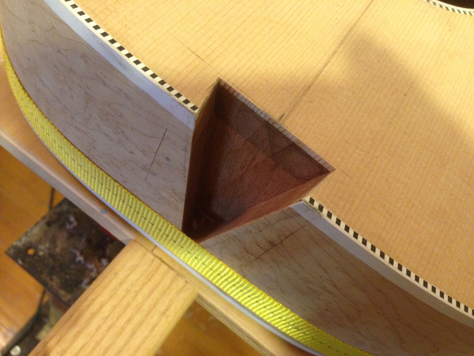 THE NECK DOVETAIL IS CAREFULLY CUT WITH A ROUTER AND A SPECIAL TAPERED ROUTER BIT.