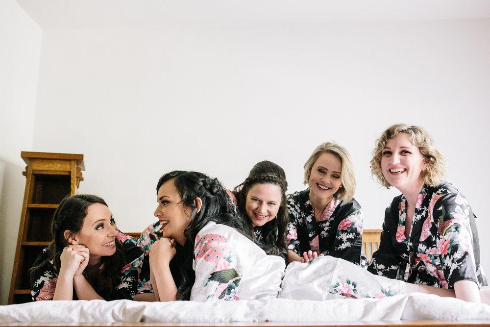 Bridesmaids and Bride have fun before wedding bells