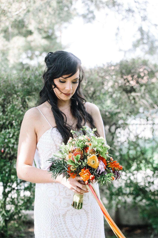Bride Gazes at Bouquet