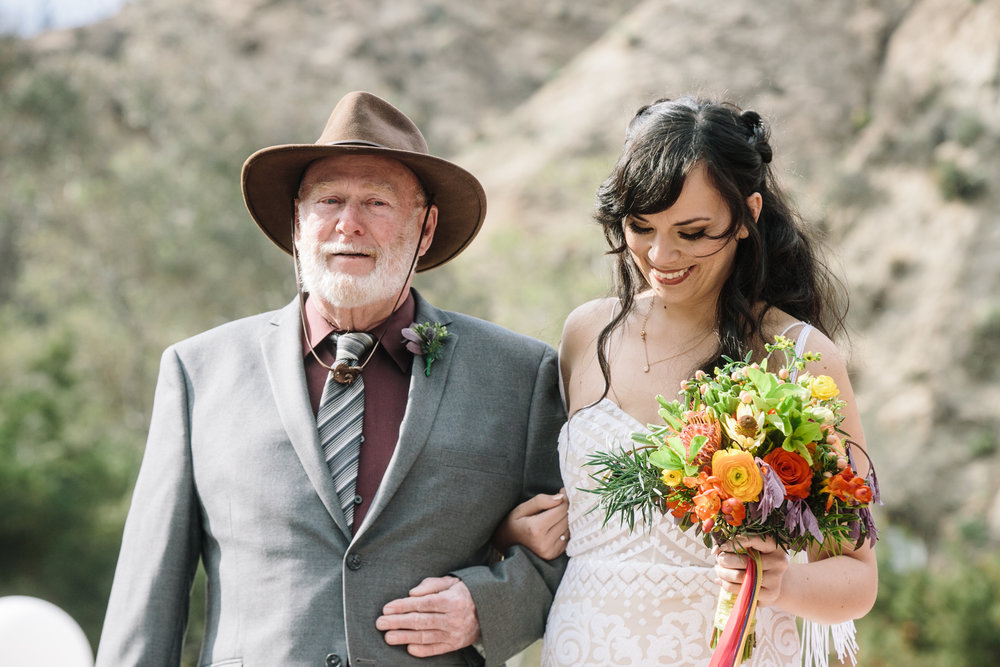 Bride and father process down the isle