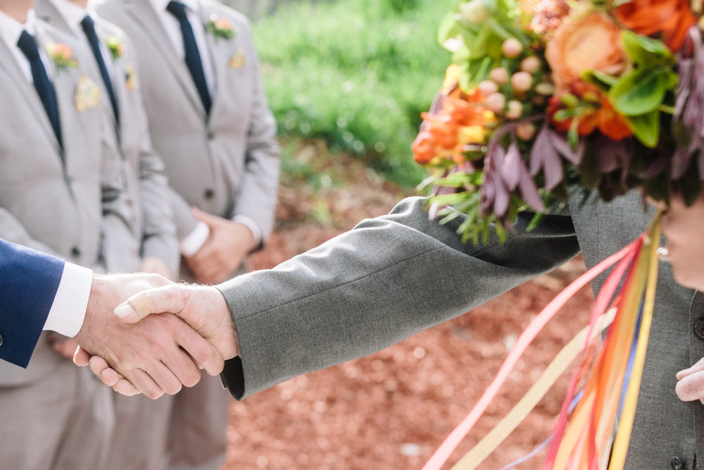 Groom and Father of the bride shake hands