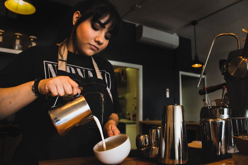 This is one of the baristas from our coffee shop. Our team of baristas study and practice for hours to perfect the craft of latte art.