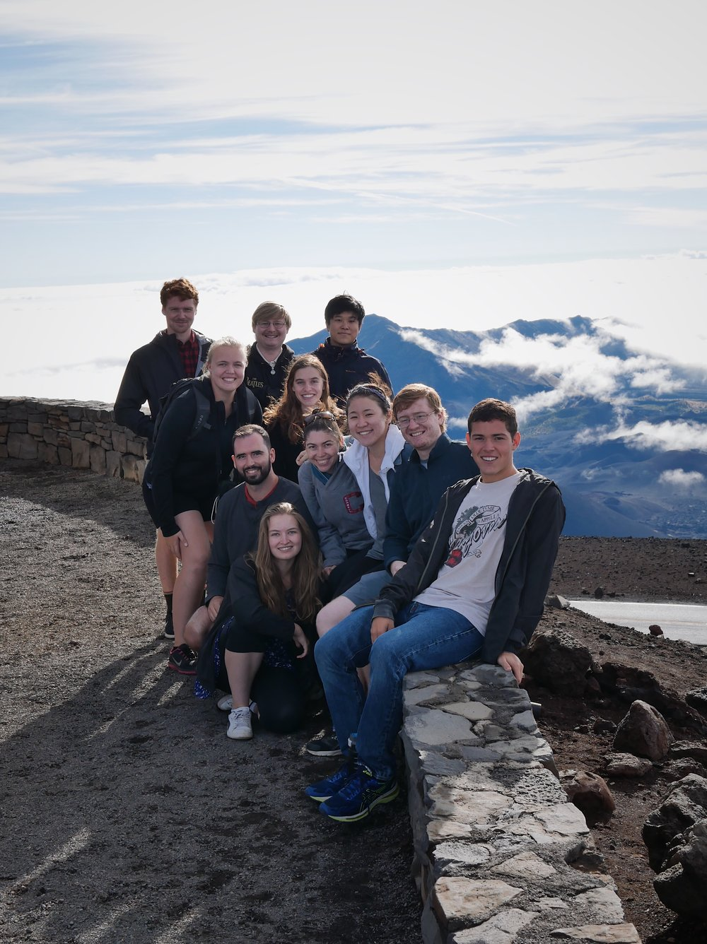 Singers pose for a photo at the top of Haleakalā