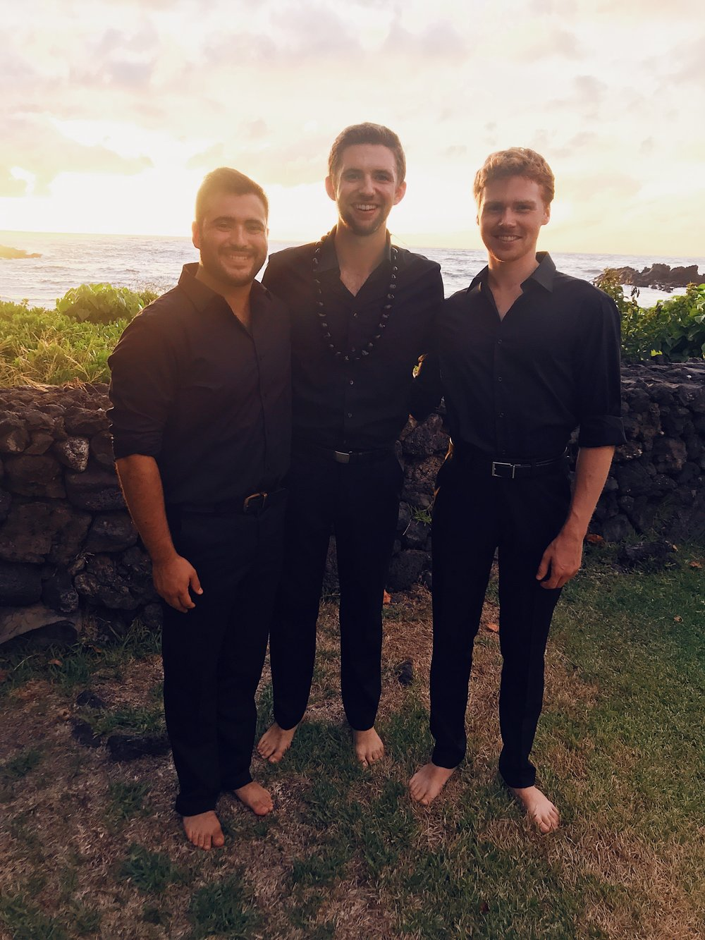 John Schafer, Tyler Brewer, and Austin Cody enjoy the sunset before a concert in Keawala'i Congregational Church
